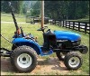 HOLLAND 18DA TRACTOR WITH 10LA FRONT END LOADER QR 54 IN MOWER DECK