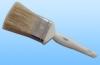 white bristle paint brush with plastic handle